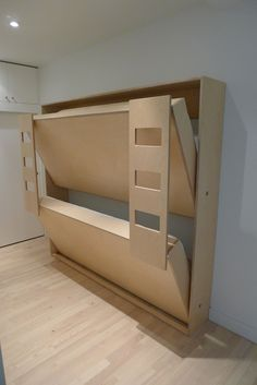 Everybody knows that this is way too modern for my tastes, but the mechanical design is close to what I want for the grandkids' bunkhouse beds. Add some shelves with baskets on gimbals so they rotate with the movement of the bed, some chain for safety catches and built in cedar to match the rest of the cabinetry in my house...yes, please and thank you.