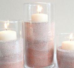 centros de mesa con arena pintada y velas