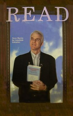 """Actor, auteur, and author Steve Martin posing with Metamagical Themas for a """"Celebrity READ"""" poster series by the American Library Association, c.1987."""