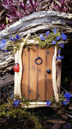 Wooden fairy door by The Faerie Architect.