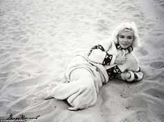 The last photos are of the starlet frolicking on a beach in her bathing suit taken by her friend, the late American photographer George Barris
