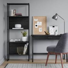 Simple and practical, the Ellis 4-Shelf Bookcase from Project 62™ is an elegant option to display your collection of books and treasures. Featuring a sleek design, the tall bookshelf is ideal for placing in your study room, home office or living room. Use the shelves to display current and favorite reads, family heirlooms, modern artwork or plants to brighten up your space. The space-saving design ensures that it can be placed in rooms with a small area, whether tucked in the corner ...