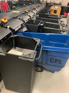 TechLogic sorter at Chicago Public with a combination of bins (e.g. black standard bins in foreground), big moveable trolleys (blue CPL trolley), SmartBins (third position) and totes (not seen in this picture Totes, Third, Chicago, Public, Big, Black, Black People, Bags, Big Bags
