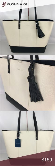 "Cole Haan Bayleen Leather Tote - Ivory and Black Authentic. New, with Tags. A few very minor marks from handling.  100% Leather. Lining, Magnetic Snap closure. 9"" Shoulder drop. 16""L x 12.5""H x 6""D. 1 interior zip pocket. Removable zipper bag. Super cute tassle.  Thank you for your interest!   PLEASE - NO TRADES / NO LOW BALL OFFERS / NO OFFERS IN COMMENTS - USE THE OFFER LINK :-) Cole Haan Bags Totes"