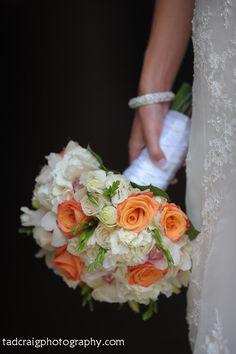 Gorgeous wedding bouquet with orange and white theme wedding.