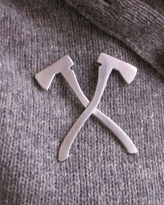 I wonder if i could use this Double Axe Silhouette Brooch as a tie pin....