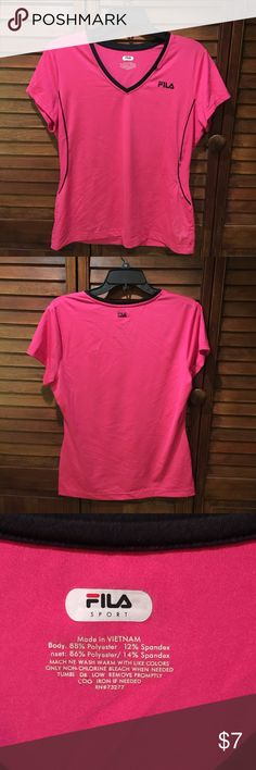MOVING SALE🎉 Fila Workout Top Pink w/black Trim fitted workout gym top, form fitting, 88% polyester, 12% spandex. ⭐⭐⭐⭐⭐ It is the BUYER'S responsibility to ensure an item will fit.  ✅ASK QUESTIONS ✅Bundle ✅Offers ❌NO Trades ❌NO Off-Site Transactions Fila Tops Tees - Short Sleeve