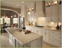 Crema Perla granite with cream cabinets and backsplash