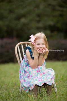 What a beautiful girl! Her little pink bow went perfectly with her outfit! She made this outdoor family photo session so much fun!