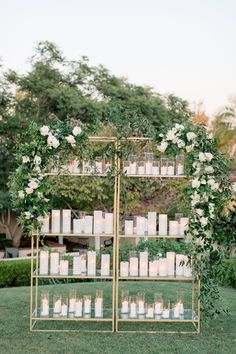 "From the editorial ""This Is Exactly What We See When Picturing a 'Secret Garden' Wedding Theme and We're Obsessed."" One of our favorite elements? Guests found their seating assignments on a vertical display of vases with the prettiest candles!  Photography: @bretthickmanphoto  #weddingescortcarddisplay #escortcarddisplay #weddingseating #weddingdecor"