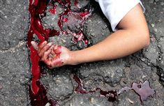Blood of a murdered boy, on the pavement.  Acapulco, Mexico, on August 15, 2011
