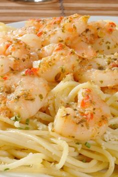 Lemony Shrimp Scampi Pasta 6 clove garlic, pressed or grated 2 lemon, zested and juiced 5 tbsp olive oil 1 tsp red pepper flakes 1 kosher salt 3⁄4 lb medium shrimp , (21 to 25) peeled, deveined and butterflied (reserve shells) 1⁄4 onion 3⁄4 lb thin linguine pasta 2 tbsp butter 1 small bunch parsley, leaves chopped 1 black pepper, freshly ground