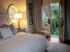 French Doors In a master bedroom, leading onto a balcony.  Just fabulous!
