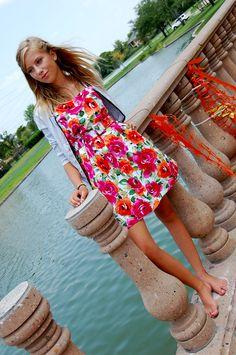 Cornelia H.  #seniorportrait #portrait #girl #youngadult #photography #floraldress #floral #dress #cardigan #blondehair #hair #longhair #windy #pillar #lake #water #ripples #beauty