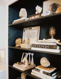 Um can you say eye-candy? Personal touches and subtle gold accents create a layered look on this built-in shelf. #decor #accessories #design