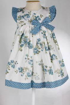 Resultado de imagem para vestido azul floral vermelho festa infantil
