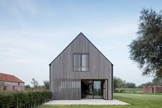 The Bunkers bed and breakfast is a former fort turned charming rural retreat that's recently opened in Belgium's Knokke-Heist Bunker Bed, Bunker Home, Porches, Timber Beds, Rural Retreats, Timber Cladding, Old Farm Houses, Small Patio, Concrete Floors