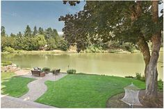This backyard with stunning views belongs to a home represented by The O'Donnell Group. #luxePNW