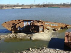 A World War 2 minesweeper underwater on the St. Louis Mississippi riverfront is now visible due to low river.