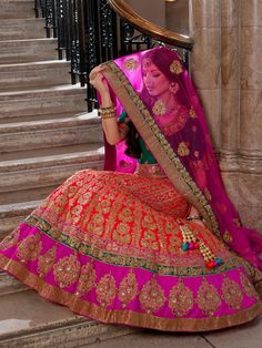 A heavily gold embroidered bridal lengha with a silk dupatta and choli.