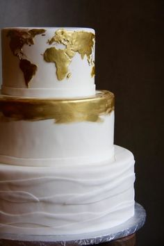 13 Wedding Details With International Flair | Love to travel? If a faraway destination isn't on the itinerary for your wedding, make it a part of your theme instead. Map it out in your décor or in this case, the dessert just like this white and gold wedding cake.