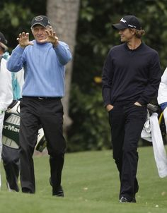 Greg Norman, left, of Australia talks with Adam Scott of Australia as they walk up the second fairway during their practice round for the Masters golf tournament at the Augusta National Golf Club in Augusta, Ga., Tuesday, April 7, 2009