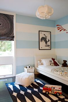Really like the horizontal lines in this room.  A way to inject color without it being too bold or too monotone.  Love this idea for a kid's room (as shown).