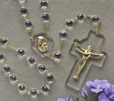 """Madonna And Child Risen Christ Crystal Wall Rosary 54"""" Long. Strikingly gorgeous this crystal wall rosary is devotional and decorative for the home or church wall. Made of Acrylic/Metal Measures 54""""L"""