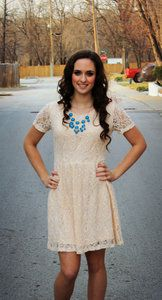 Beautiful cream lace dress with shirt sleeves. Hits mid thigh