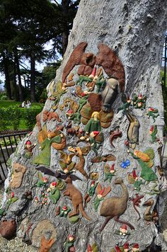 Ola Cohn's Fairy Tree, in Fitzroy Gardens, Melbourne comprising a series of lovely carvings on the stump of one of the original Red Gum trees.