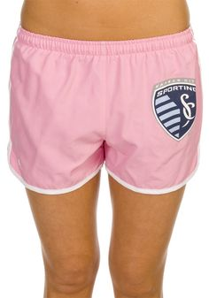 "Show your love for Sporting Kansas City while out and about in these Sporting KC Womens Pink ""Flipside"" Running Shorts! These Ladies Pink SPKC jogging shorts feature a contrasting white trim around the legs and the Sporting KC shield logo on the left leg."