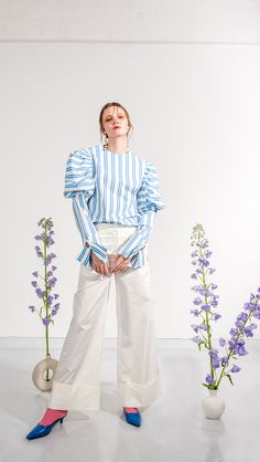 The Marcelle Pant in off-white. Wide trouser with folded hem and concealed hook and eye zip closure at front. Loose fit.
