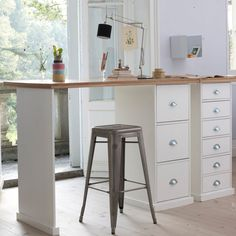 Tall desk with storage, natural light and inspiring view.    Bureau Tanguy