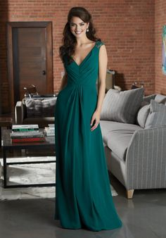 Shop Morilee's Beautiful Chiffon Bridesmaid Dress Accented with Lace Cap Sleeves.  Stylish Chiffon Bridesmaid Dress Featuring a Pleated V-Neckline Bodice Accented with Lace Cap Sleeves. An Open Keyhole Back Completes the Look View the Lace Swatch Card for Color Options. Shown in Emerald.