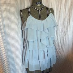 Periwinkle blue ruffled blouse Elegant periwinkle blue ruffle layered top with beautiful back. Tops Blouses