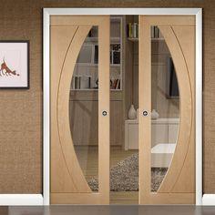 Double Pocket Salerno Oak Door with Clear Safe Glass, Prefinished. #modernpocketdoors #contemporarydoors #contemporarypocketdoors