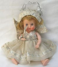 Vintage Tudor-Rose doll dressed as a Christmas Tree Fairy. I have this doll, not as a fairy or with a wig, and a black version too