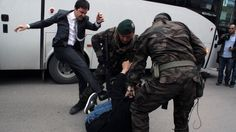 An aide to Turkey's president kicked a protester. Then photos of the assault started disappearing.