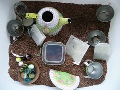 Tea Sensory Bin - How cute!  A tin tea set, flaxseed, real teabags and other fun stuff :)