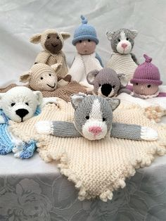 Knitting pattern for Mini Cuddly Blankies with Cat, lamb, polar bear, doll and koala. - There are 5 characters included in this set: Cat, lamb, polar bear, doll and koala. The finished lovey blanket measures 14 Inches/34cms Square or diameter. Directions for frilly edge and corded square blanket; frilly and corded circular blanket. Also include is a choice of collar or straps to finish off the cuddles neatly.