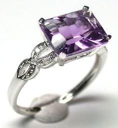 Faceted amethyst in an unusual cut with 3 small diamonds on each side, set in 14k white gold