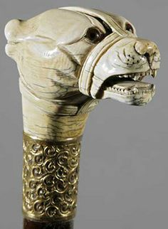 antiques price guide, antiques priceguide, miscellaneous, England, An antique English carved ivory dog head handle cane, 19th century, glass eyes, gold-plated brass collar with monogram EF [wood shaft].
