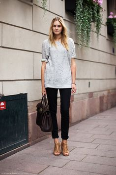 Loose gray top, black skinny jeans, brown high-heeled sandals/booties