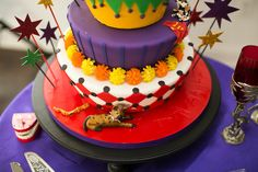 Jaime & Mike's Wedding Photo By Renouf Photography.  cake by http://www.charmcitycakes.com/about-us  Joker and Harley Quinn wedding cake comic book wedding