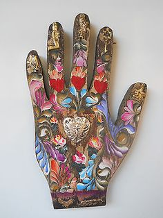 mexican folk art decoration beautiful wood hand with a heart and 7 milagros .