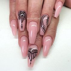 Nude Pink with Black Nail Art. The simpler the better. Nude pink with Black nail art on the coffin nails is the best example of this saying.