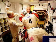 oldest-astronaut-john-glenn-getting-suit-checked + uniforms of USA / NASA ground crew
