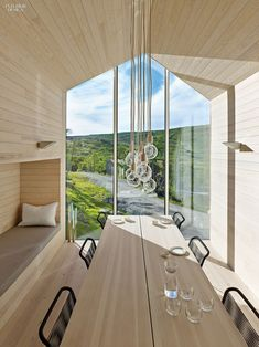 Reiulf Ramstand Architects   clad a weekend house near Hol, Norway, with   local pine. Photography by James Silverman.