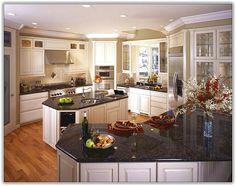 off white kitchen cabinets with black granite