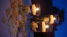 Puedes usar en las mesas que no tendran flores. esta es una idea bonita, solamente le quitaria las rosas que tienen y les dejaria el agua con las velas y solamente usas 2 en vez de tres (como se mira la foto) . Tambien puedes usar  candelabras , todo depende el set up.